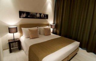 Slaapkamer van appartementen New York Residence in Budapest