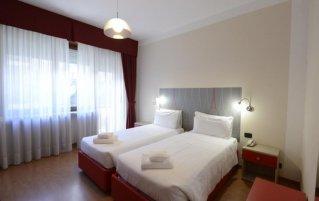 Tweepersoonskamer van hotel Tourist