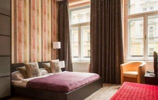 Slaapkamer van Appartementen Royal Court Legerova in Praag