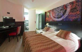 Slaapkamer van hotel Bastion in Maastricht