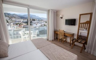 Slaapkamer van hotel Villa Flamenca in Nerja