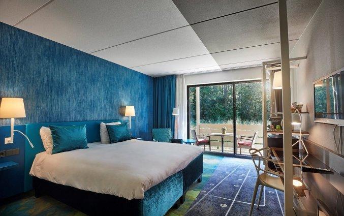 Slaapkamer van Hotel Carlton President