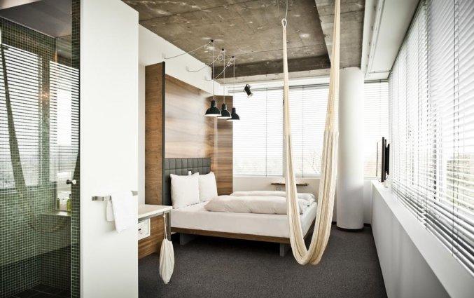 Kamer met hangmat in Hotel Daniel Vienna in Wenen