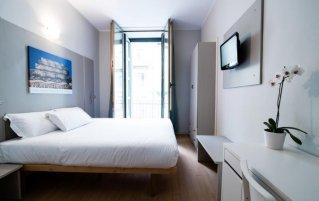 Tweepersoonskamer van hotel Astoria Turijn