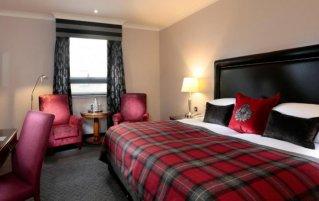 Slaapkamer van hotel Macdonald Holyrood in Edinburgh